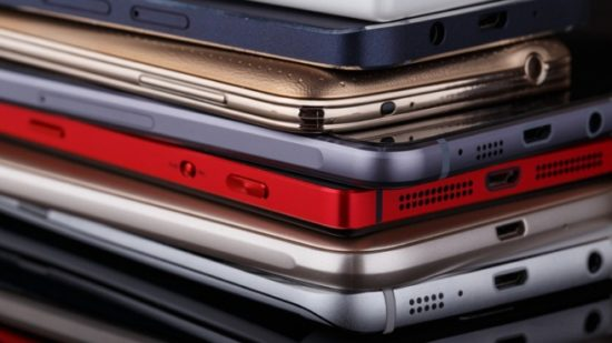 heap-of-electronical-devices-close-up-smartphones-on-black-background-picture-id658486984